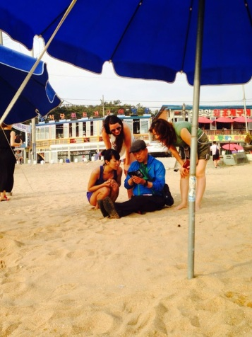 The Korean man that took a full beach photo shoot for us and then printed us out polaroids